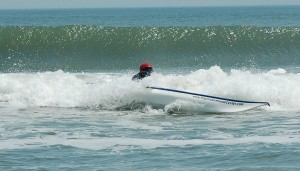 side surfing in a sea kayak