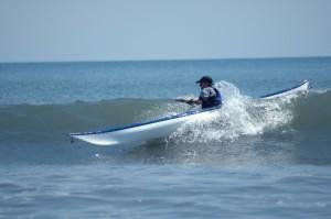 Tom Noffsinger surfing a sea kayak