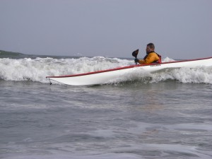 Photo of sea kayak surfing
