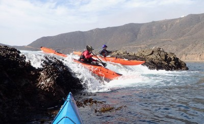 Kayak going over rock ledges in Baja, Mexico